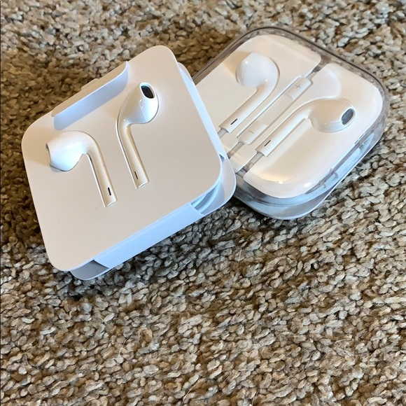 2 pair of apple head phones. New and older.